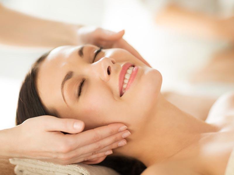 a lady having facial treatment