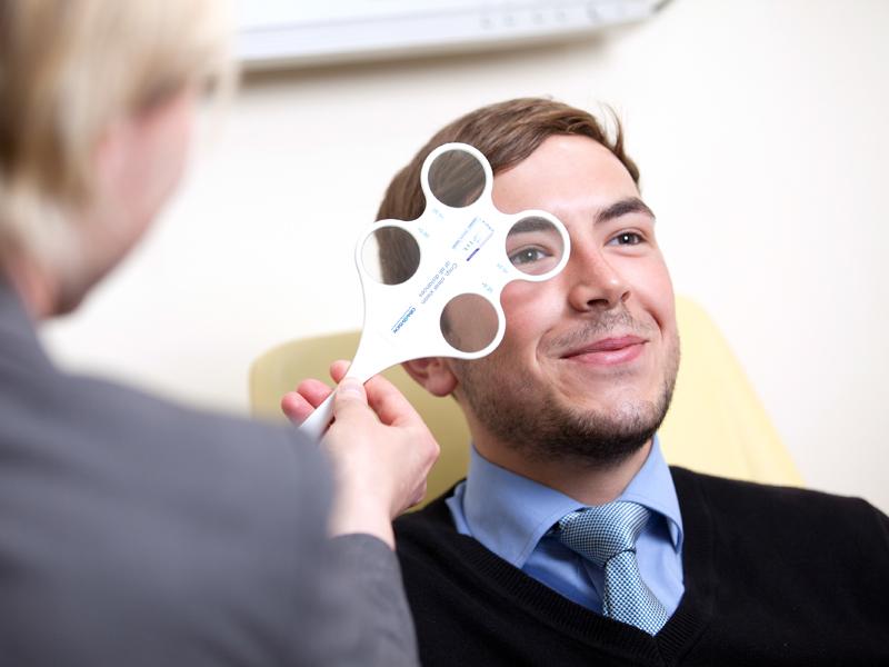 optometrist take an eye test
