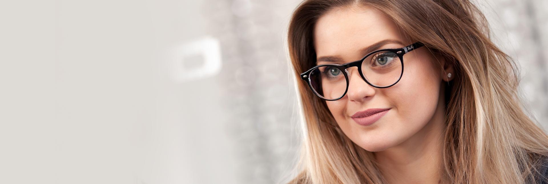 girl wearing designer glasses
